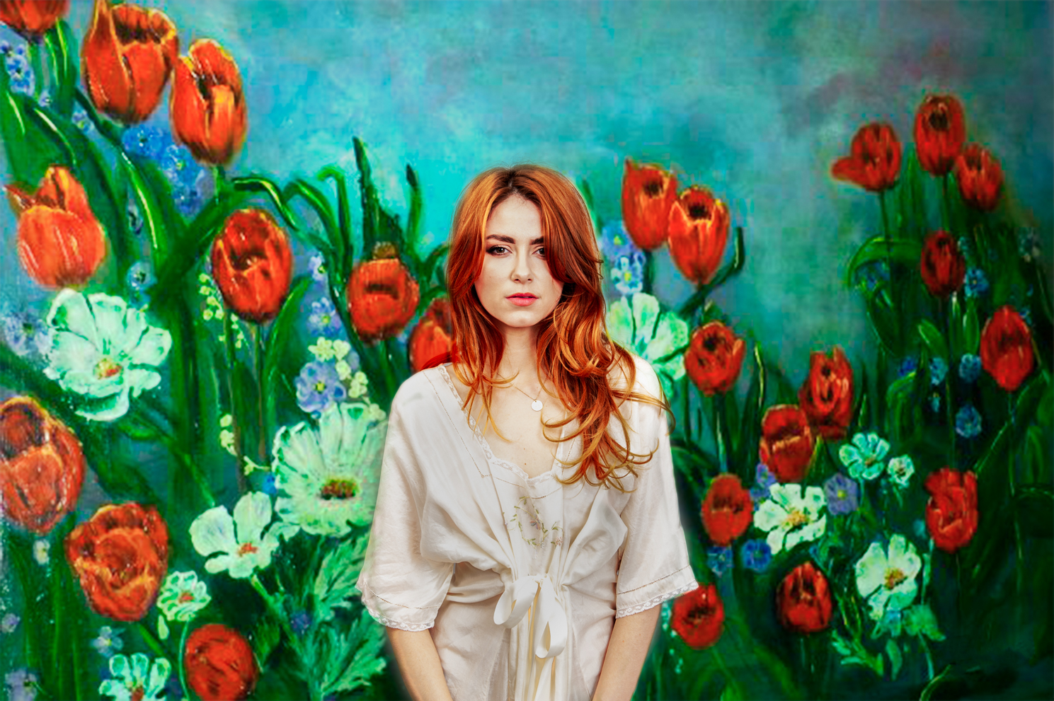 Fine art portrait of a red head model surrounded by wild flowers by Farnham, Surrey based fashion photographer James Muller