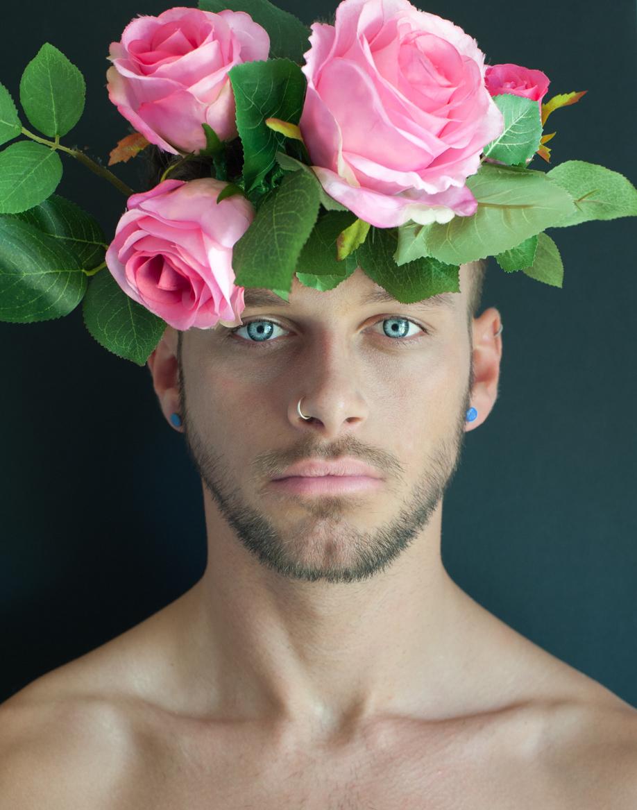 Flower crown and blue eyes. Fine art portrait by Farnham, Surrey based fashion photographer James Muller