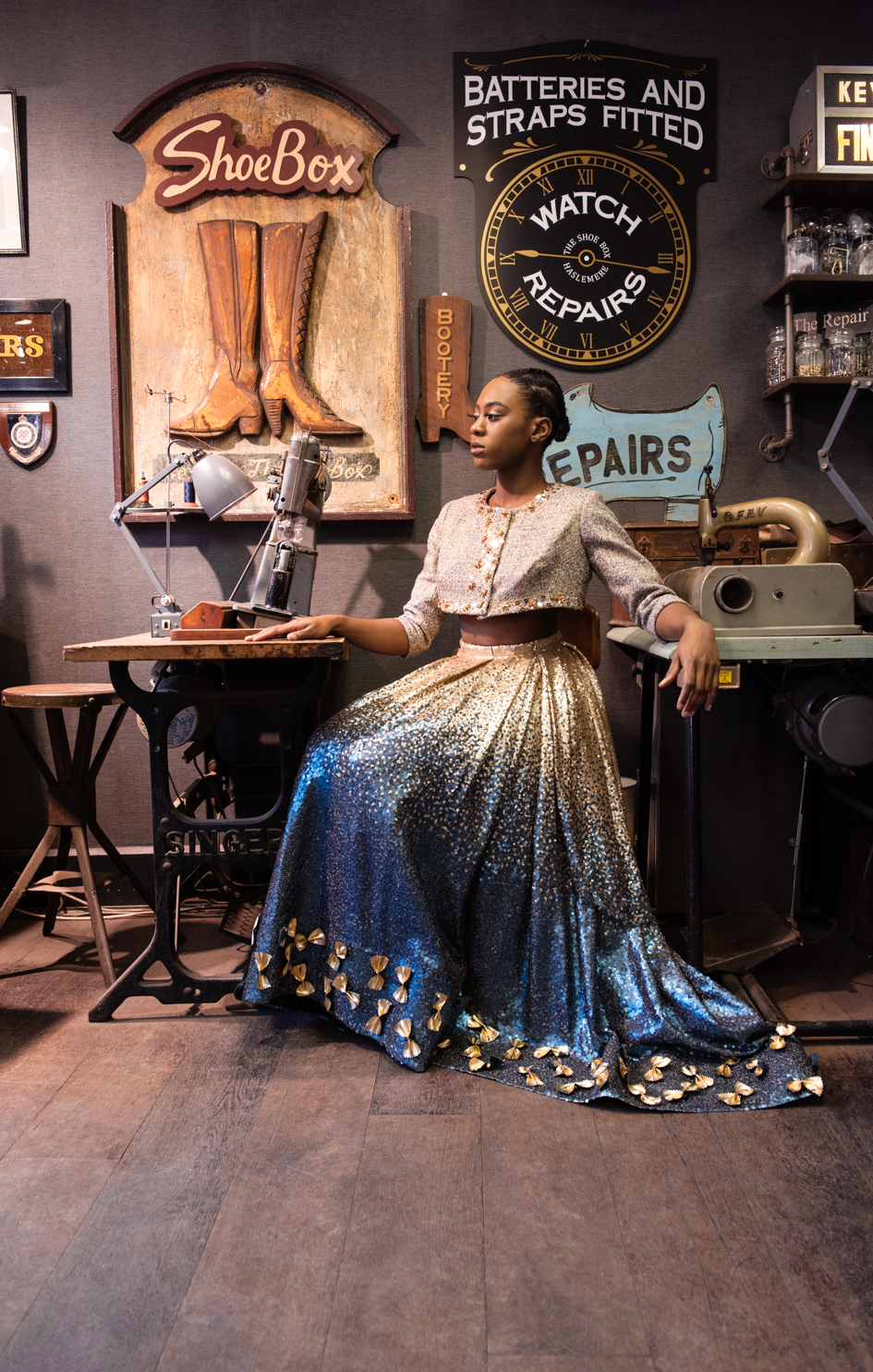 African model in gold and blue dress for costume designer Francis Campbell. Fine art fashion photography by Farnham, Surrey based photographer James Muller
