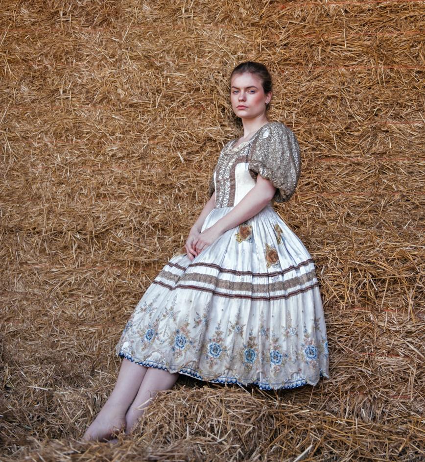 Sitting woman. Fine art renaissance portrait by Farnham, Surrey based fashion photographer James Muller