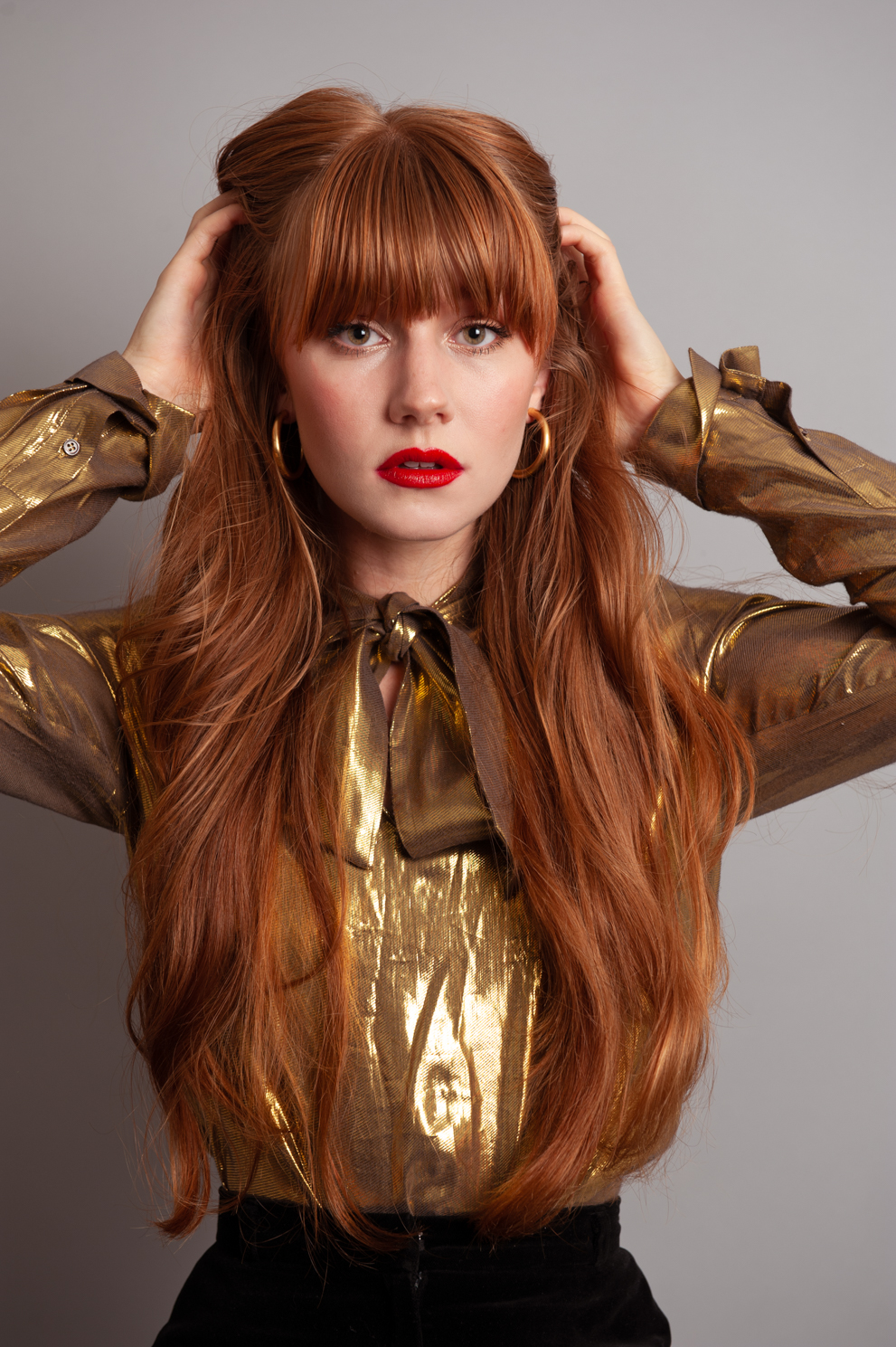 Redhead in gold. Fashion photography by Farnham, Surrey based portrait photographer James Muller