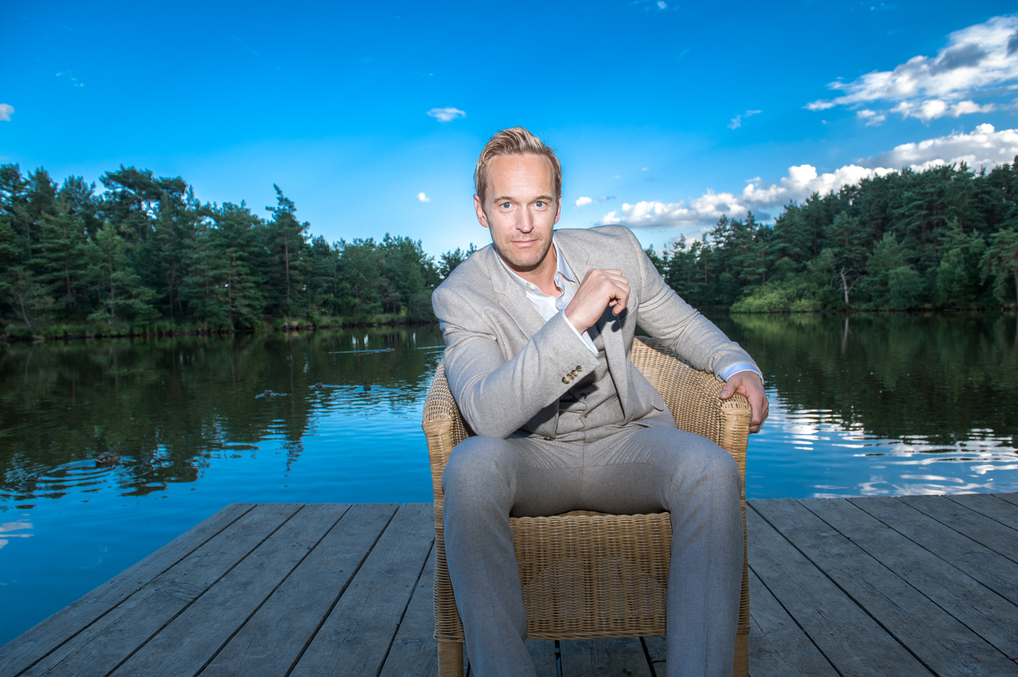 Man by the lake. Wedding photography by Farnham, Surrey based portrait and fashion photographer James Muller