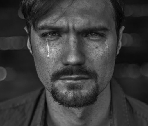 The crying man. Black and white fine art portrait by Farnham, Surrey based fashion photographer James Muller